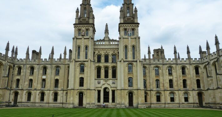 Oxford university collage building with grass lawn